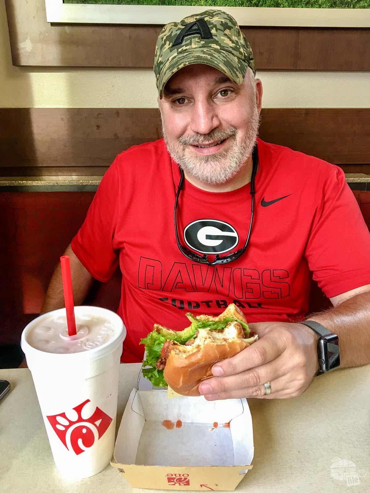 Grant enjoying a chicken sandwich at Chick-fil-A.