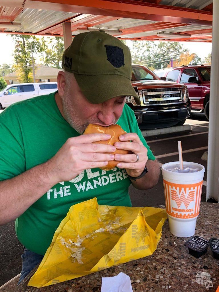 Grant enjoying a burger at Whataburger.
