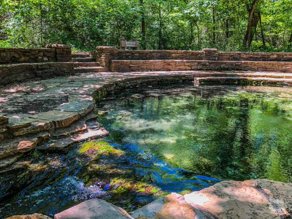 A circular sitting area surrounding Buffalo Springs in Chickasaw National Recreation Area.
