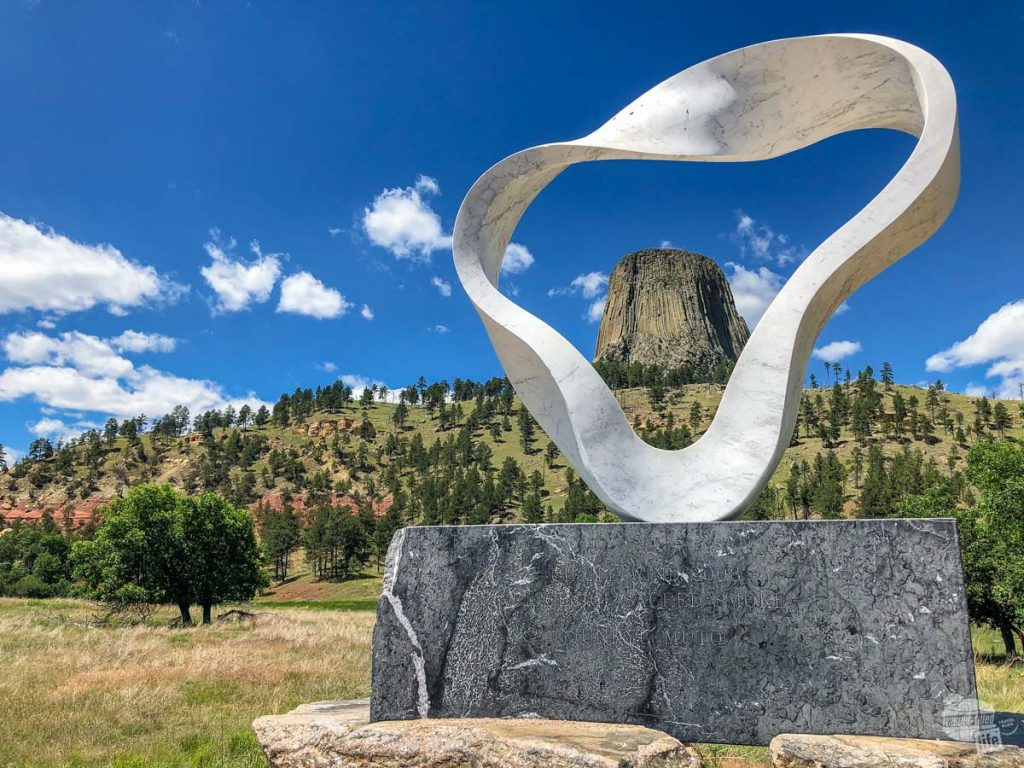 """The """"Wind Circle"""" Statue framing Devils Tower. One of the last things to do at Devils Tower you would expect is view modern art designed to work with the tower."""