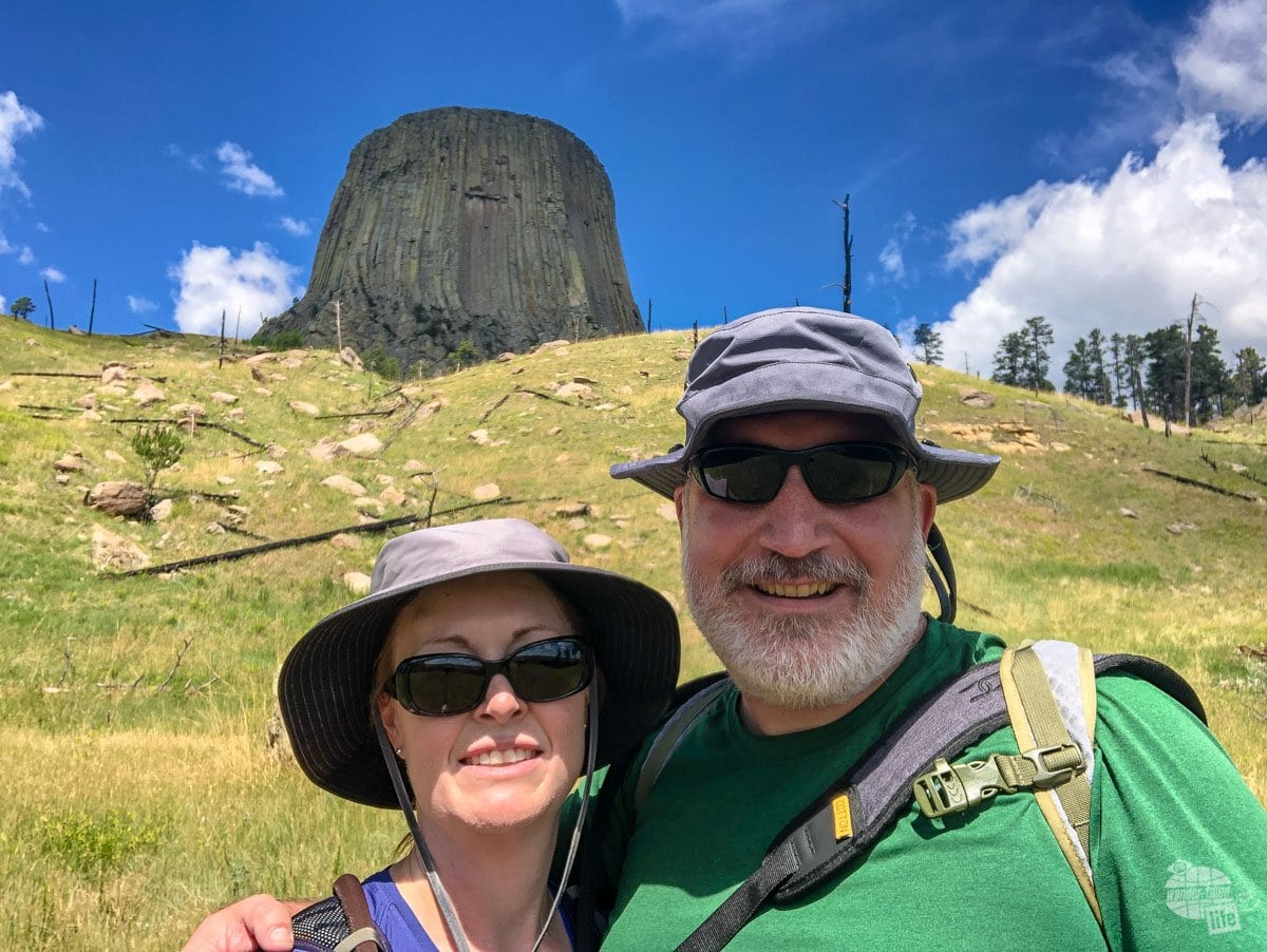A selfie of Grant and Bonnie Sinclair with Devils Tower in the background.
