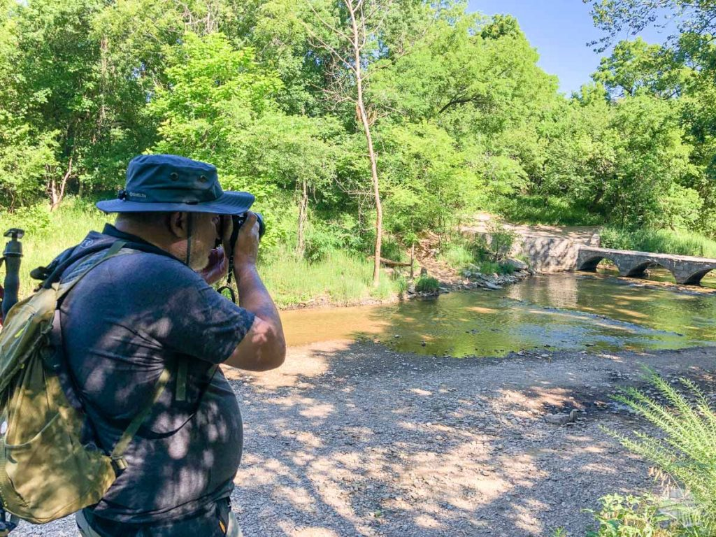 Grant taking a picture with his new camera at Travertine Creek.