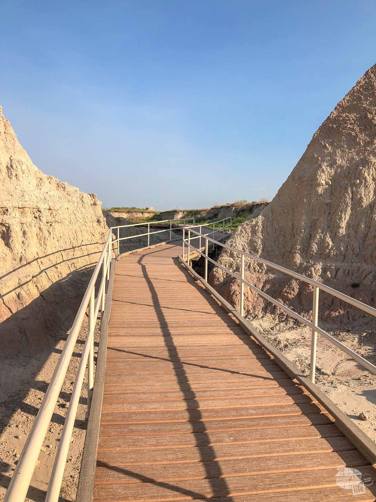 A boardwalk leading through a gap in the Badlands Wall.
