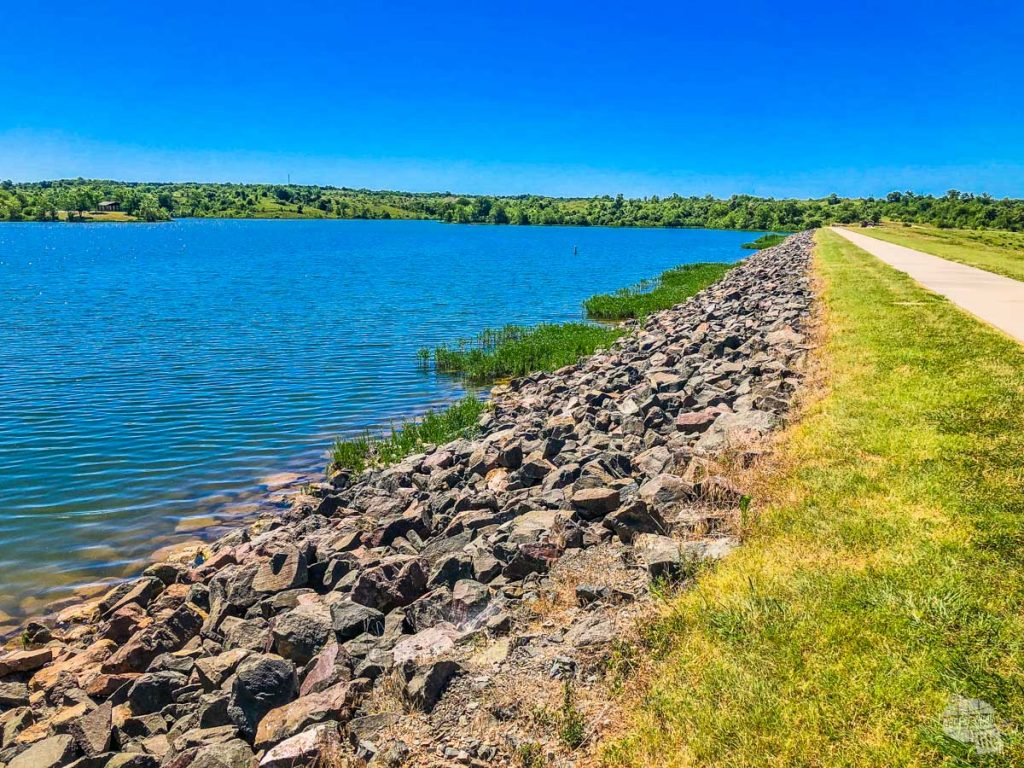 A view of Veterans Lake in Chickasaw National Recreation Area with the trail to the right.