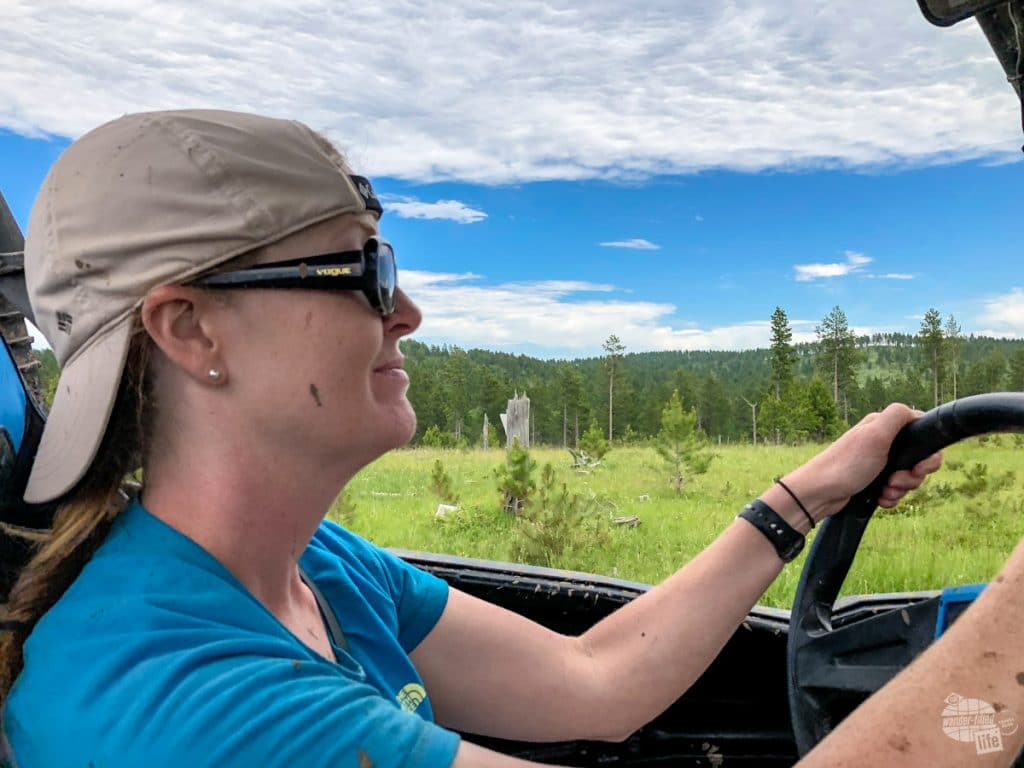 Bonnie drives the ATV in the Black Hills.