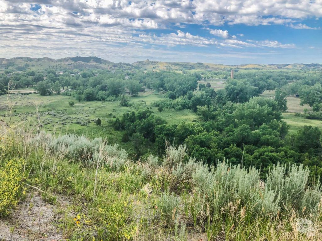 The view from the Medora Overlook. The chimney was the old meat processing plant.