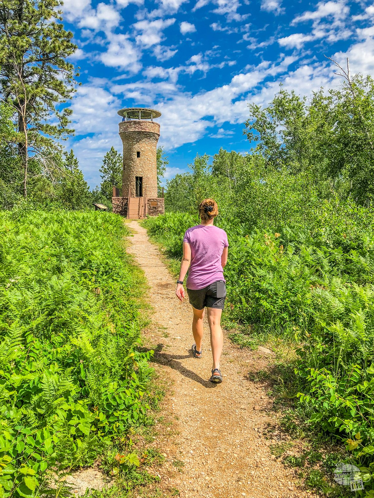 Bonnie walking up to the Mount Roosevelt Friendship Tower, a monument dedicated to Theodore Roosevelt by his long-time friend Seth Bullock.