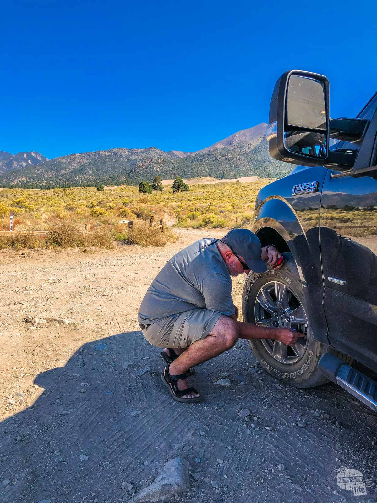 Grant airing down the tires to avoid getting stuck in the sand... It wasn't necessary for this drive.