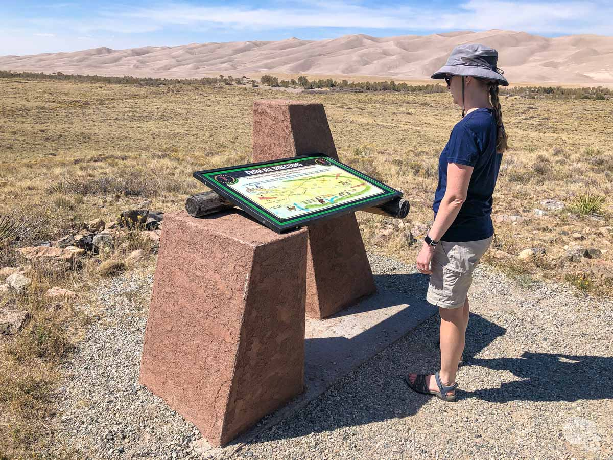 Bonnie stopped to read the informational sign on the Sand Shelf Trail.