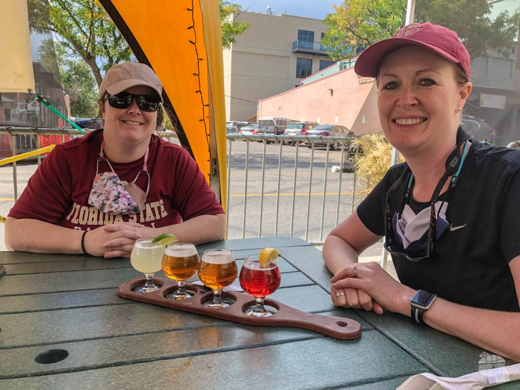 Bonnie and her sister, Molly, sampling a flight of beer at Carver's in Durango.