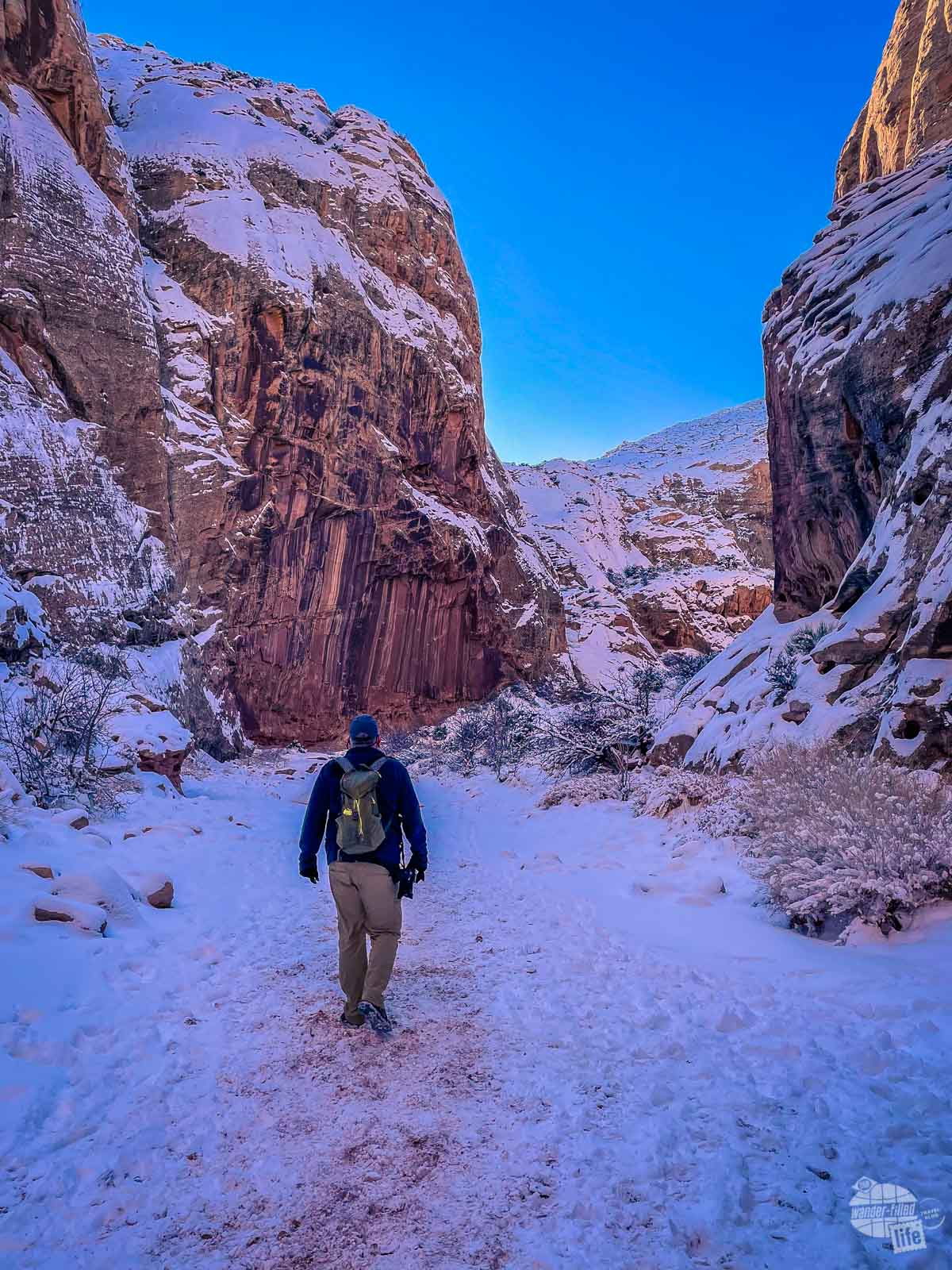 Grant hiking on the Grand Wash Trail in Capitol Reef National Park in the winter.