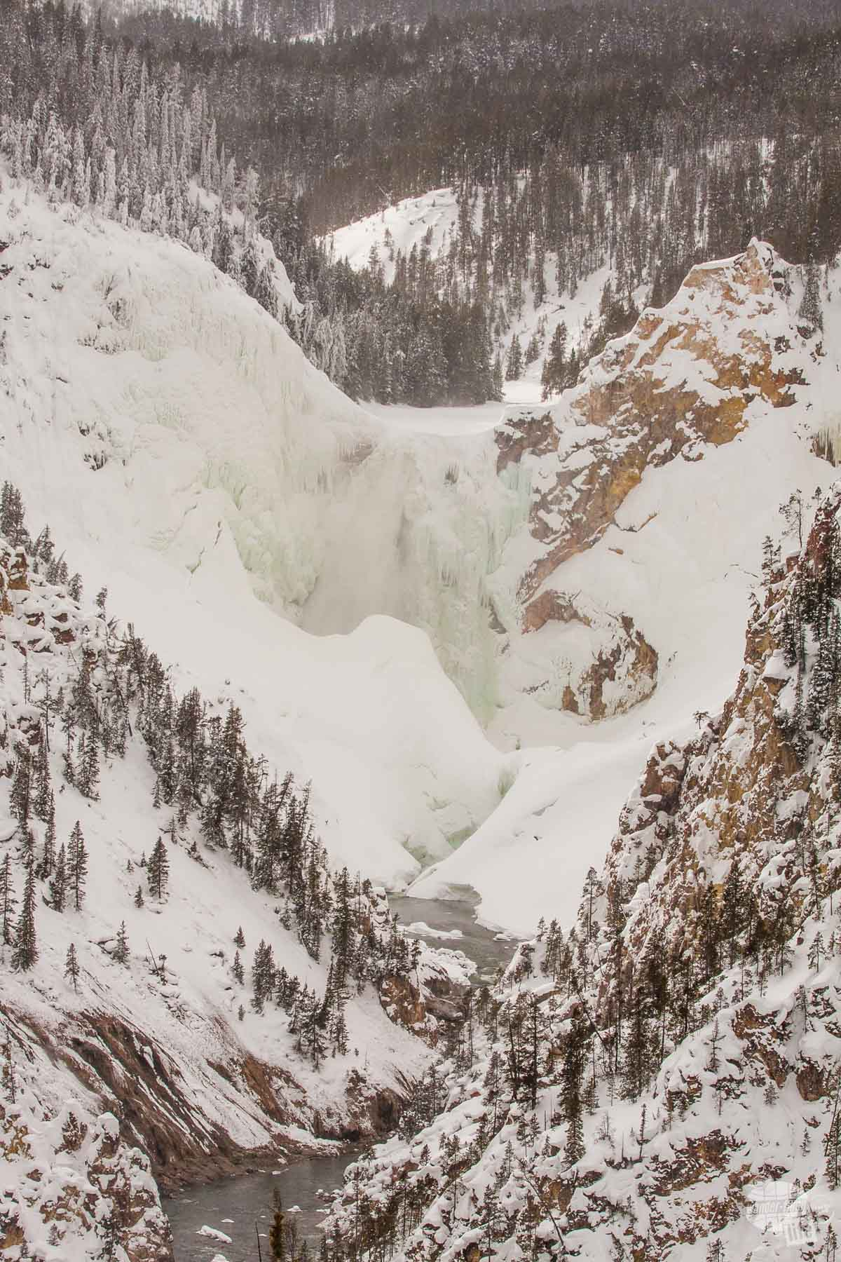 Expect frozen waterfalls at Yellowstone National Park in the winter.