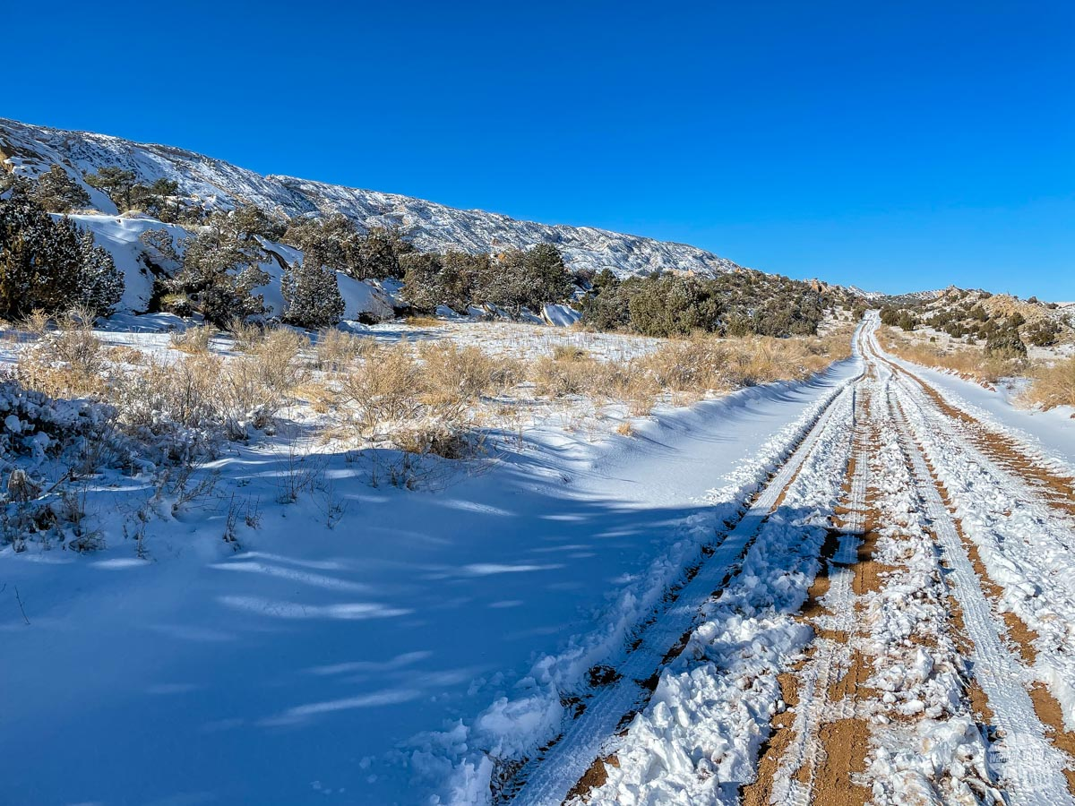 The snow-covered Notom Road going through Capitol Reef National Park.