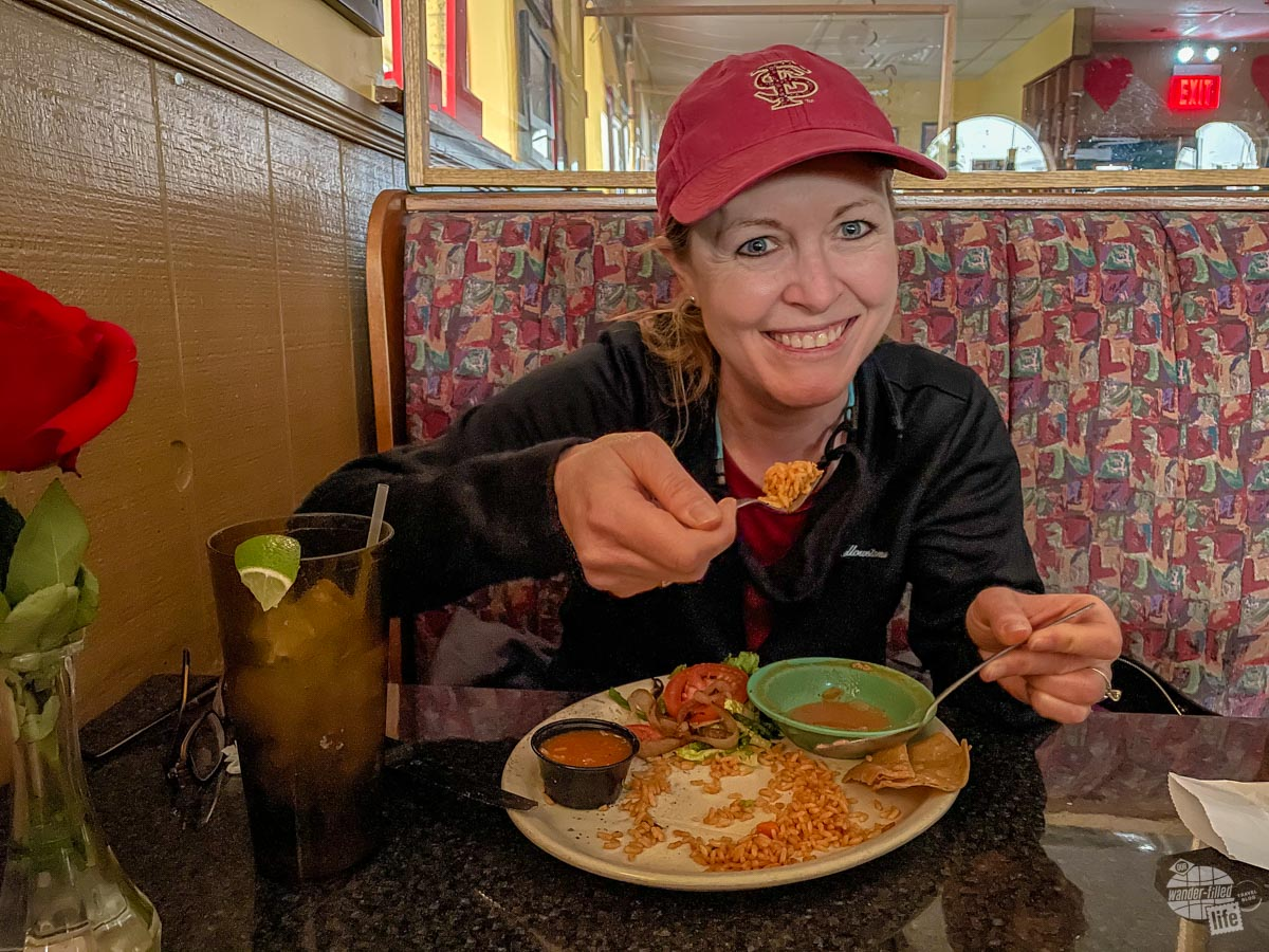 Bonnie scooping some rice from her plate in a Mexican restaurant just after the power went out.