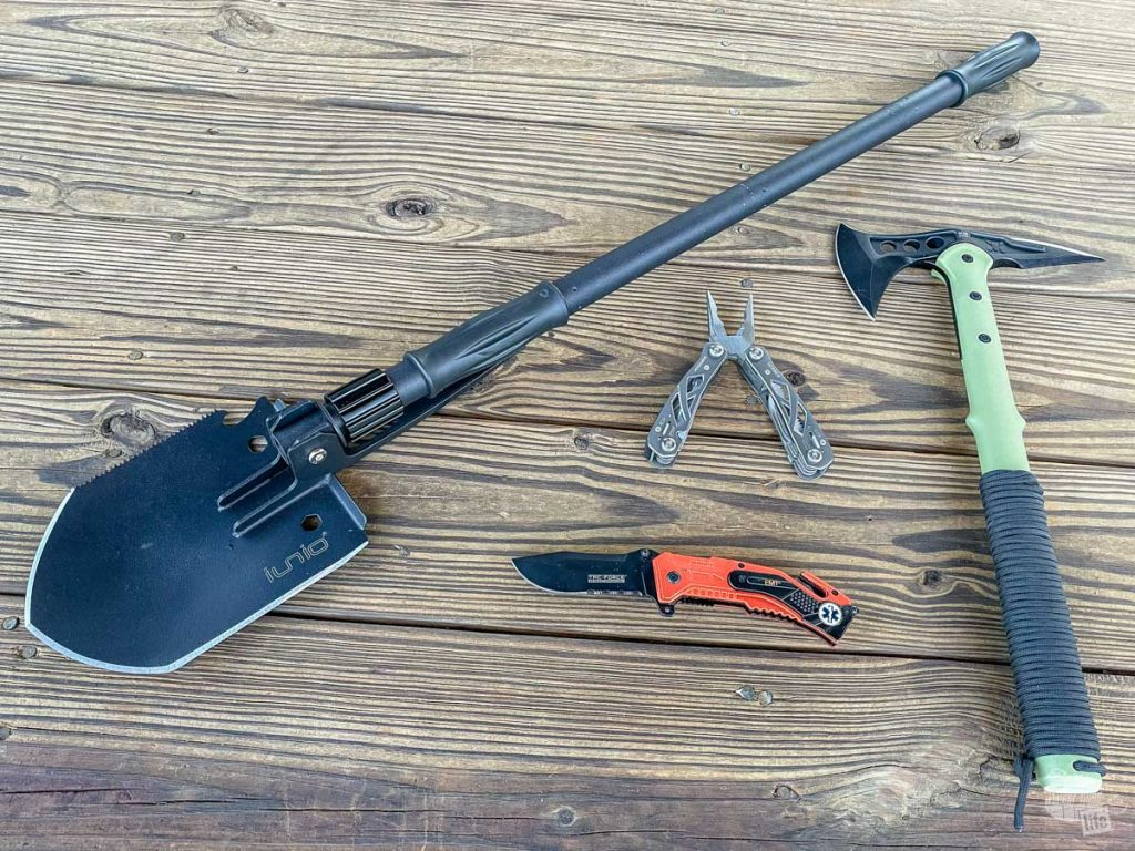 My travel emergency tools include a Iunio shovel, a Gerber multitool, a Ranger Tomahawk and an extraction tool.