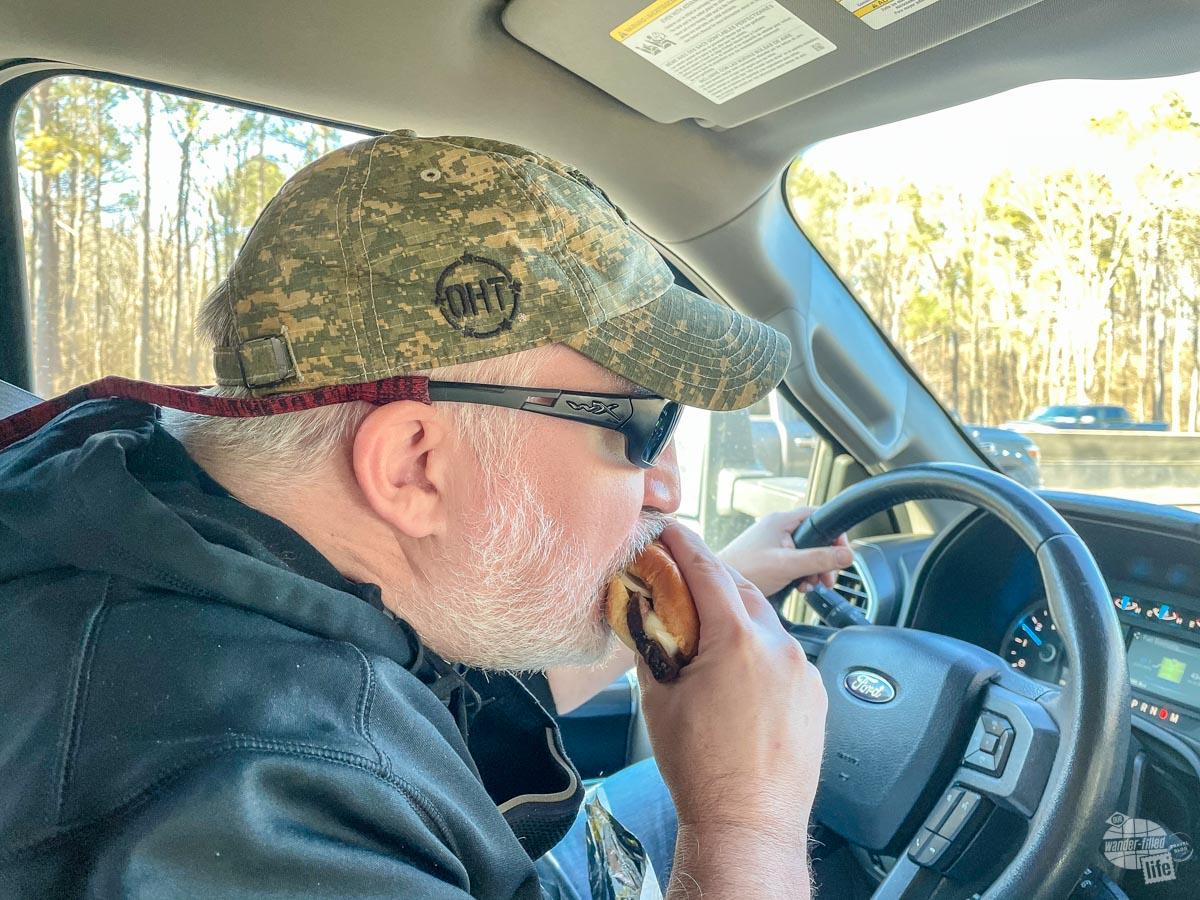 Grant bites into a Buc-ee's brisket sandwich.
