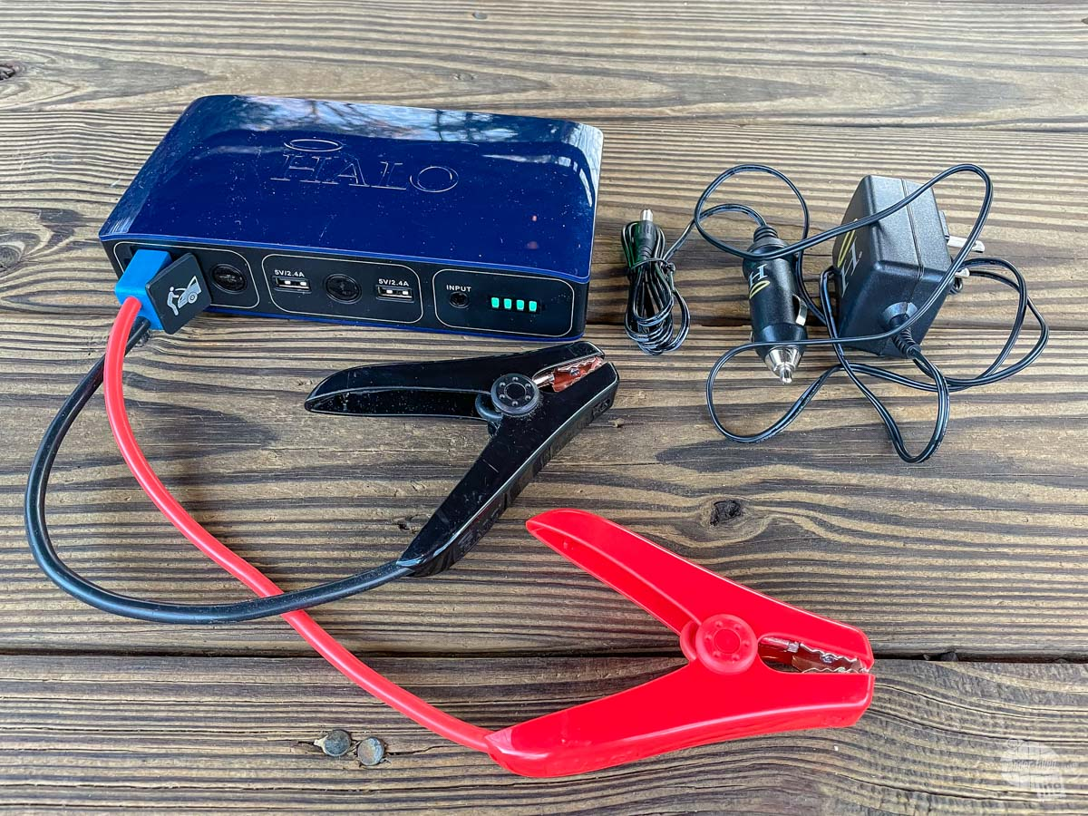A Halo Bolt battery jump start system is essential for a travel emergency kit.