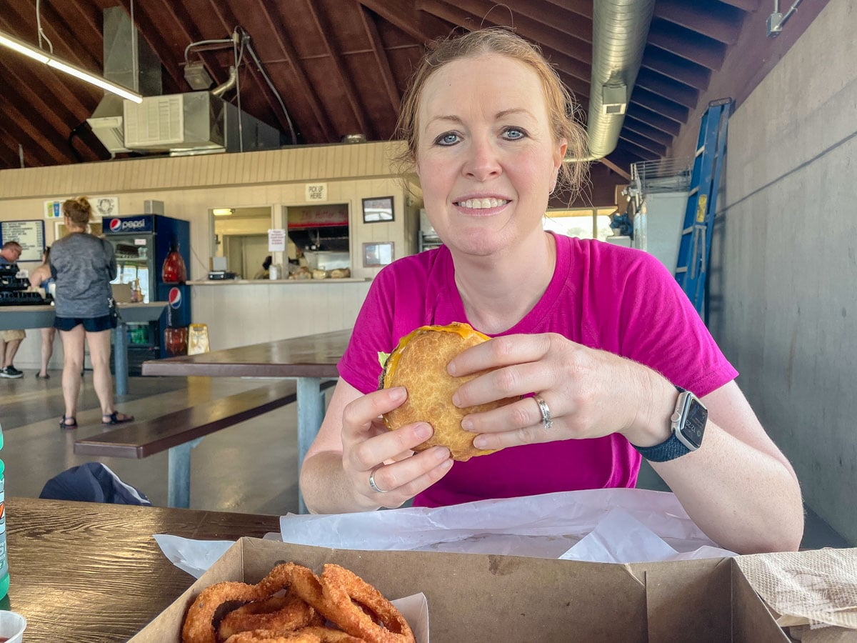 Bonnie enjoying a bison burger at the Island Buffalo Grill.
