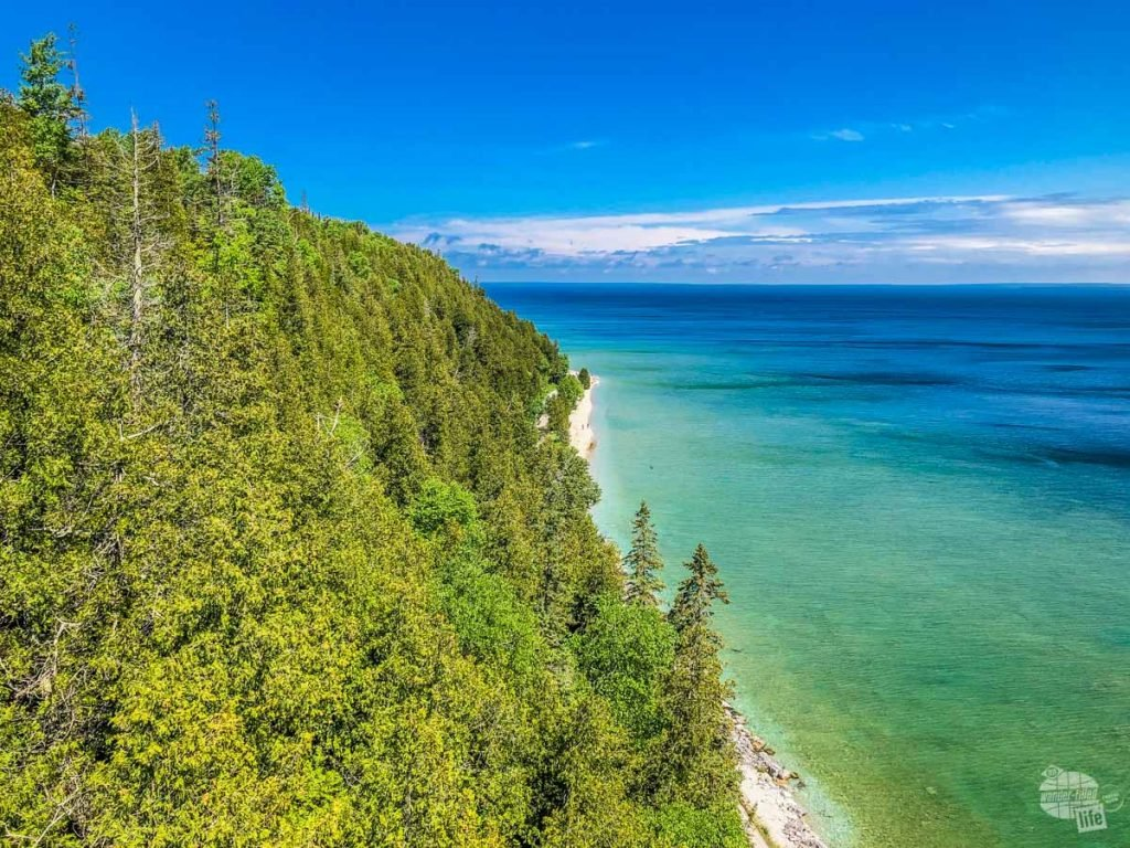 Blue-green waters of Lake Huron and the coastline of Mackinac Island.