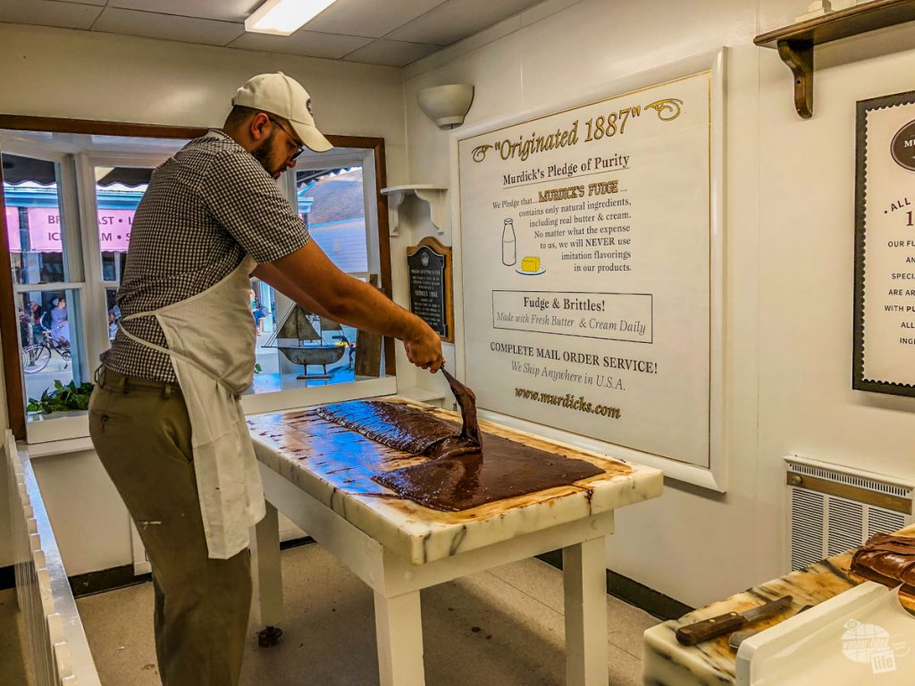 A worker makes fudge at Murdick's on Mackinac Island.